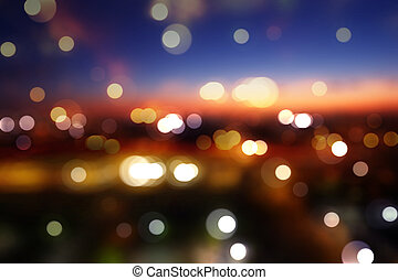 Blurred cityscape background scene at twilight