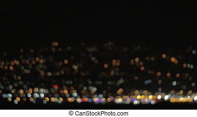 Blurred colorful city lights - Defocused loop video of...