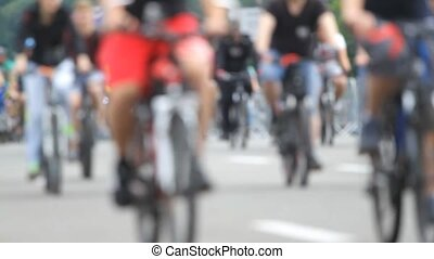 Blurred crowd of cyclist in the street