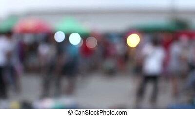 blurred crowd of people walking