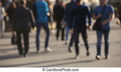 Blurred crowd walking down busy street, city life rush concept