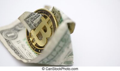 blurred crumpled dollar money and different bitcoin...
