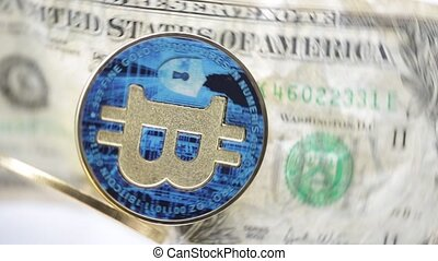 crumpled dollar money and different bitcoin - blurred...