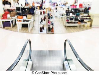 Blurred, de focused shopping mall, escalator
