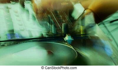 DJ - Blurred. DJ shows his skills.