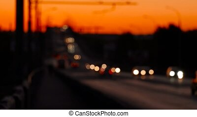 Blurred Dramatic Red Sky Of Sunset And Flow Of Commuters Cars