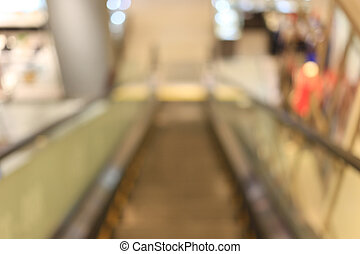 Blurred escalator in the shopping mall.