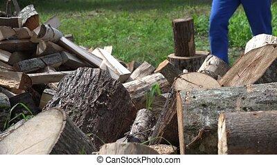 blurred farmer man chop wood with axe. 4K - Cut tree trunk...