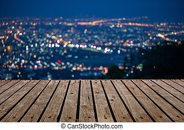 Blurred focus of big city in night time, cityscape, Bokeh of the city at night.