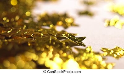 Blurred golden stars falling in slow motion at table