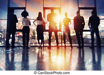 Blurred group of business partner looking for the future. Concept of corporate and startup