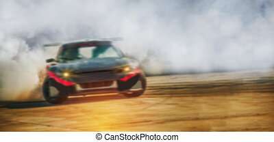 Blurred image of car drifting on race track, Motor sport concept.