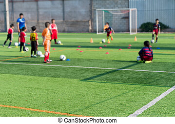 Blurred image of Children Training in Soccer academy