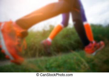 Blurred image of running women