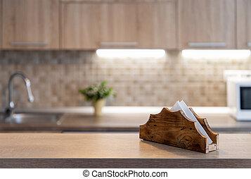 blurred kitchen interior and wooden desk space home background