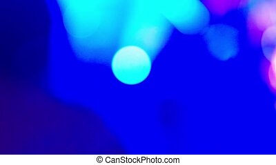 Blurred lighting in a nightclub for background. Low light toned image. Bokeh for background concept.