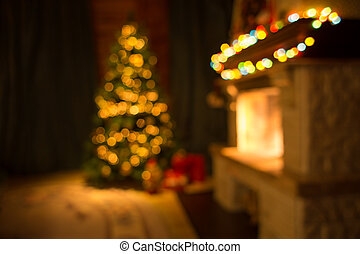 Blurred living room with fireplace and decorated Christmas tree background