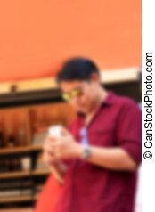 blurred man using smart phone