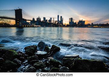 Blurred Manhattan skyline with Brooklyn Bridge