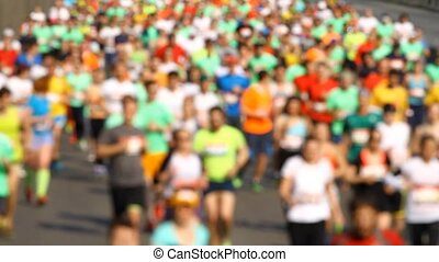 Blurred mass of marathon out runner