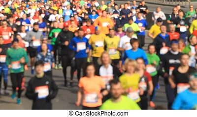 Blurred mass people of marathon