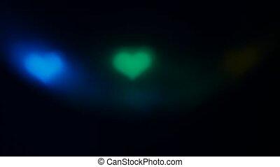 Blurred mirror disco ball in bokeh heart