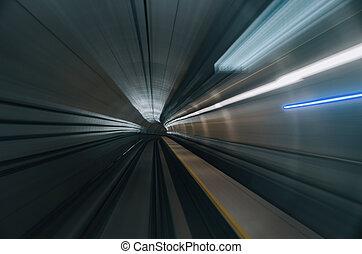 blurred motion effect background under subway tunnel