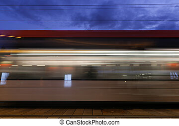 Blurred Motion Metro - Side view blurred motion metro on a...