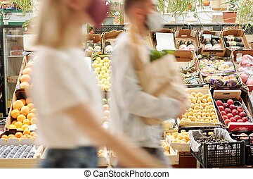 Blurred motion of people at food market