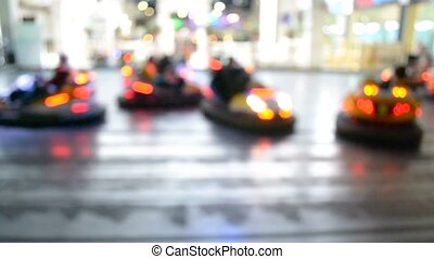 Blurred motion of people driving bumper cars