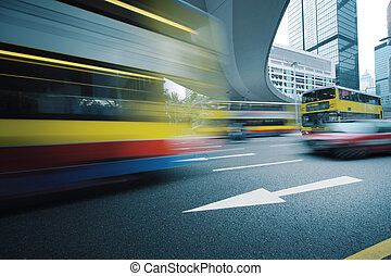 Blurred motion - Long exposure photo of bus moving on urban...