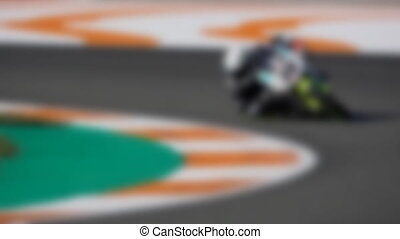 Blurred motorcycle traces curve in slow-mo - Blurred racing...