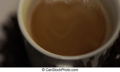 Blurred movie. Coffee from the coffee machine is poured into a white cup