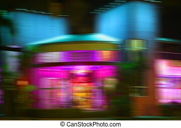 Blurred night colorful motion lights in Miami Beach downton