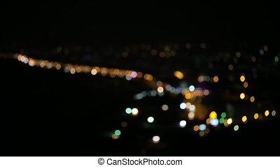 Blurred night lights - Blurred night city lights on a black...