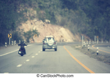 Blurred of driver riding motorcycle on the road