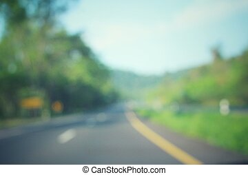 Blurred of road with trees