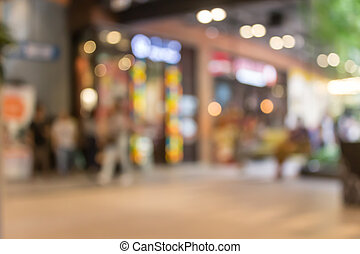 Blurred of shopping in department store with bokeh background