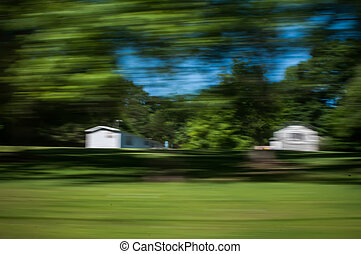 blurred out country landscape while driving