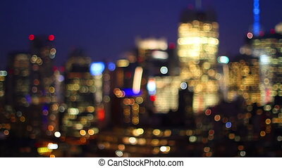 blurred panning video of midtown manhattan skyline shot from a high vantage point at night