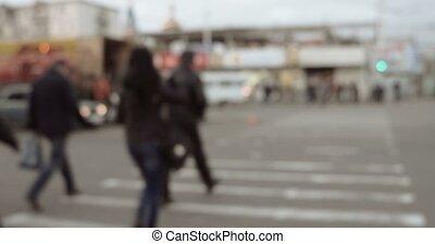 Blurred Pedestrians walking via zebra crossing in Astrakhan,...