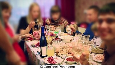 Blurred People eating food from served table on catering or buffet party on business seminar conference, wedding or birthday