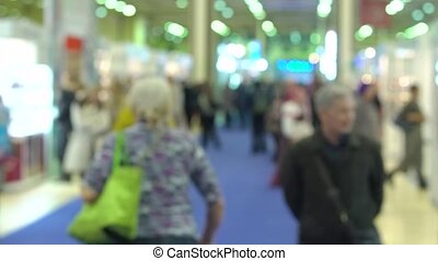 Blurred people in a exhibition hall.