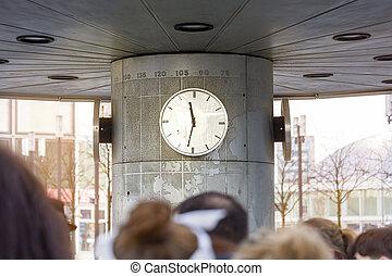 blurred people in front of a clock, Alexanderplatz Berlin