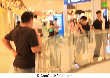 Blurred people in shopping mall