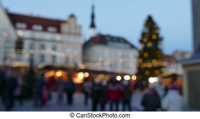 Blurred People walking at Traditional Christmas market in European old town