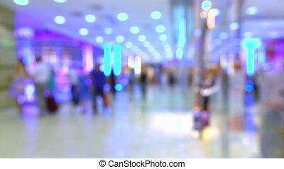 Blurred people walking in modern shopping mall. 4K bokeh video