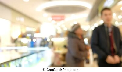 Blurred People Walking In Supermarket