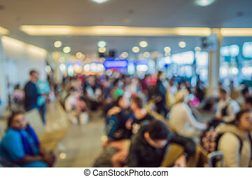 Blurred photo. People waiting for boarding at the airport.