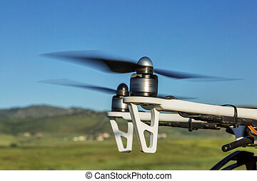 blurred propellers of airborne drone